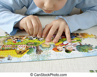 puzzle assembling 1 - close-up of the child\\\'s hands...