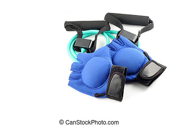 gym equipment - blue workout gloves with light weights on...