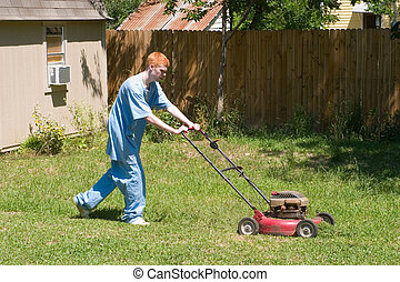 Teen Mowing Lawn 4 - Red-haired teenaged boy mowing the lawn...