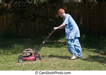Teen Mowing Lawn 6 - Red-haired teenaged young man mowing...