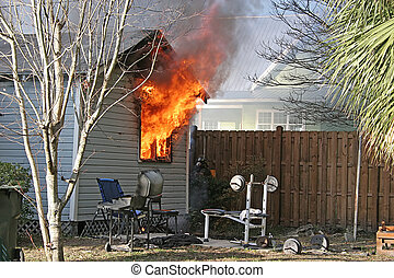 House Fire 1 - Small house ablaze with fire blowing through...