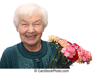 Old woman with flowers - Smiling old woman with bunch of...