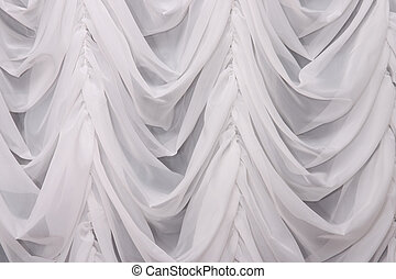 White curtain - Hanging draped white curtain