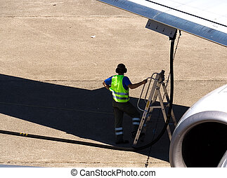 Airplane refueling - Ramp agent refuels airplane