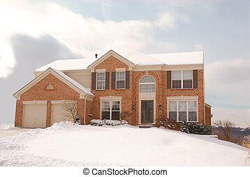 House on a Hill in the Cold of Winter - a two story brick...