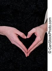 Hands make heart - A womans hands form a heart against the...