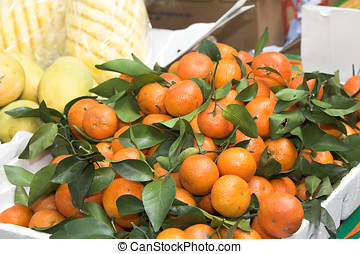 Juicy mandarines for sale - Juicy mandarines at a market for...