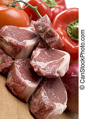 rib lamb chops meat prime cut with vegetables on cutting...