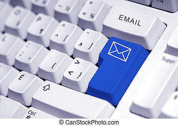 Email button - email button on a white keyboard computer