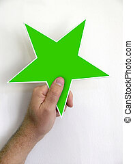 Hand Holding Green Star