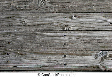 Beach Planks 2 - Close up of sandy, weathered planks on...