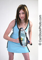 Almost serving - A young sexy woman in a blue tennis dress...