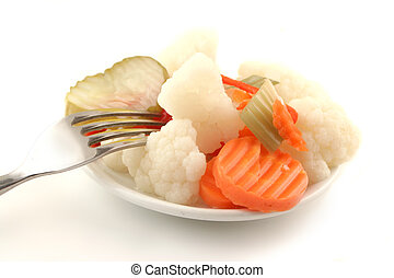 pickled vegetables - variety of pickled vegetables with fork...