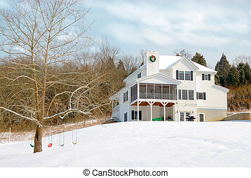 Snowed In - A beautiful 3 story home sitting on a snow...