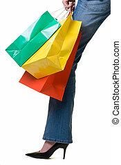 shopping - Leg of a woman holding onto a bunch of colorful...