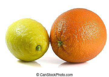 Orange and Lemon isolated on white reflective surface