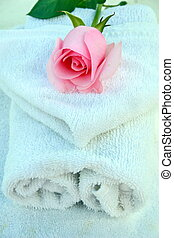 roses and spa - A beautiful pink rose resting on spa towels