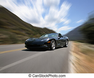 Corvette Speeding on a Mountain Road With Intentional Radial...