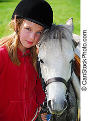Girl and pony - Portrait of a young girl with a white pony