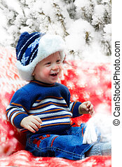 young boy outdoor - Happy smiling young boy sitting on the...