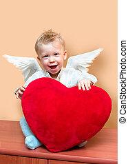 angel boy - Laughing cute angel boy with big plush red...