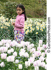 child flower - chinese girl in a tulips garden in denmark