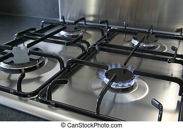 Gas hob - A four ring brushed steel gas hob with focus on...