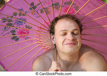 Happy guy - Happy man holding a japanese umbrella