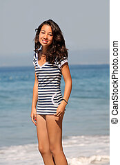 Girl by the sea - Asian girl standing by the ocean