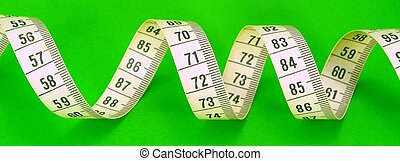 Measuring Tape - Measuring tape on green background