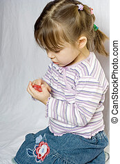 curiosity - little girl playing with red heart shaped soap