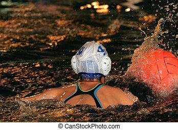 Water-polo - The floating child in water with sparks and red...