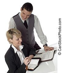 couple - young business couple working in office on white