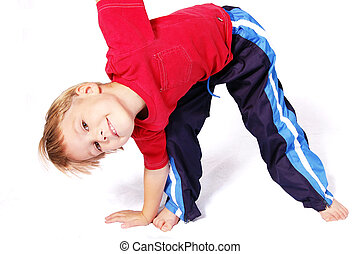 Bend To The Right - A cute four year old boy wearing red and...