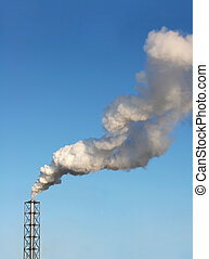 Pollution - One metal chimney and smokestack against the...