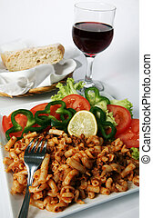 Bistro - A plate of meat pasta and salad, served with...