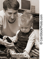 father and son - Father playing with his son in car repair...