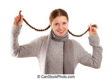 Plaits - Cute young woman holding her hair plaits