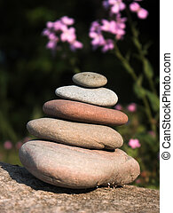 balance - rocks balancing on a bigger rock,shallow dof