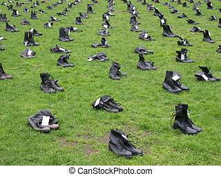 Boots representing each soldier killed during the war in...