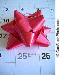 Christmas Day on a calendar with a red bow
