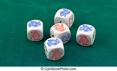 Poker dice on green felt, showing four of a kind.
