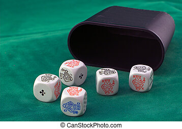 Poker dice on green felt, showing a full house - Jacks over...