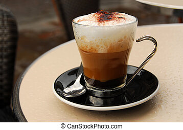 Cappuccino - Cup of coffee on outdoor patio table