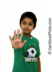 Stop gesture - A Kid yelling stop against a white background