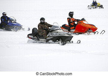 Sno Group - Snowmobiling on an ice coverede lake