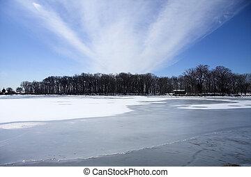 Cabin on frozen lake