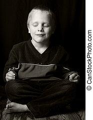 Sukhasana - a child sits in Sukhasana pose