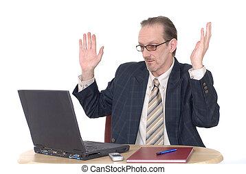 Surprised looking Businessman working on laptop -...