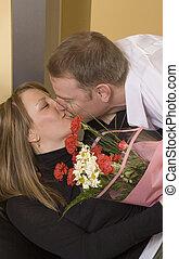 man offering flowers